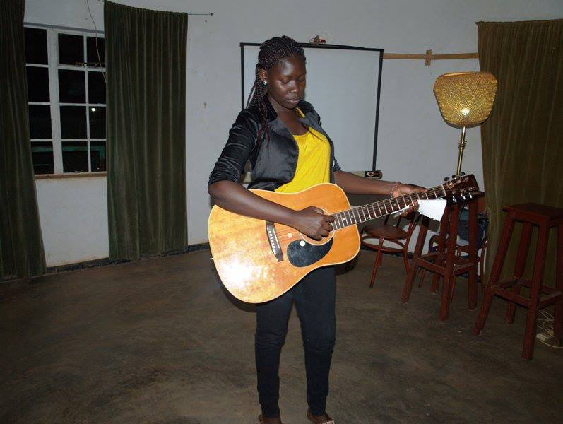 Xera during a recital in Gulu