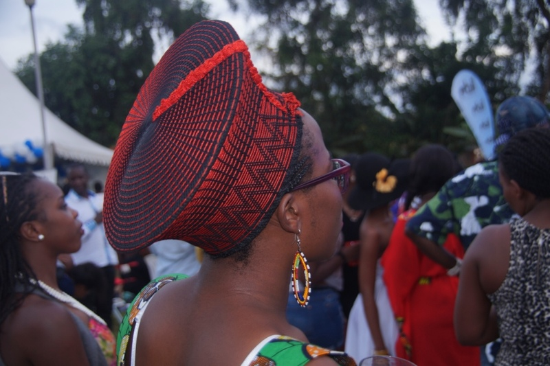 "Sandra Atukwase. Student of Social Sciences at Makerere University. She says that this hat was a birthday gift from her mum. ""I'm proud to be donning African art."" These hats first became popular when Brenda Fassie came to Uganda."